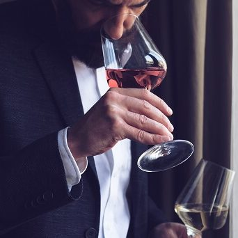 man-tasting-a-glass-wine